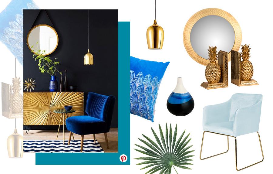 Decoración 2019: Ambiente de sala de estar con una poltrona color azul y celeste, mueble con detalles dorados, espejo con marco dorado , lámpara dorada y asujeta libros en el mismo color