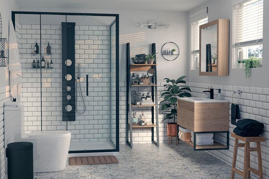En este baño decorado en el estilo industrial, destaca la ducha con mampara de vidrio.