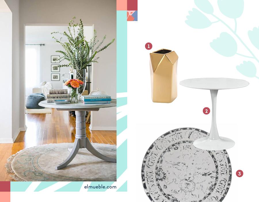 Una mesa pequeña y redonda, delimitado con una alfombra y adornos queda muy bien en el recibidor. Selección de productos: 1-Florero cerámica geo / 2-Mesa roma blanca / 3-Alfombra redonda babil gris