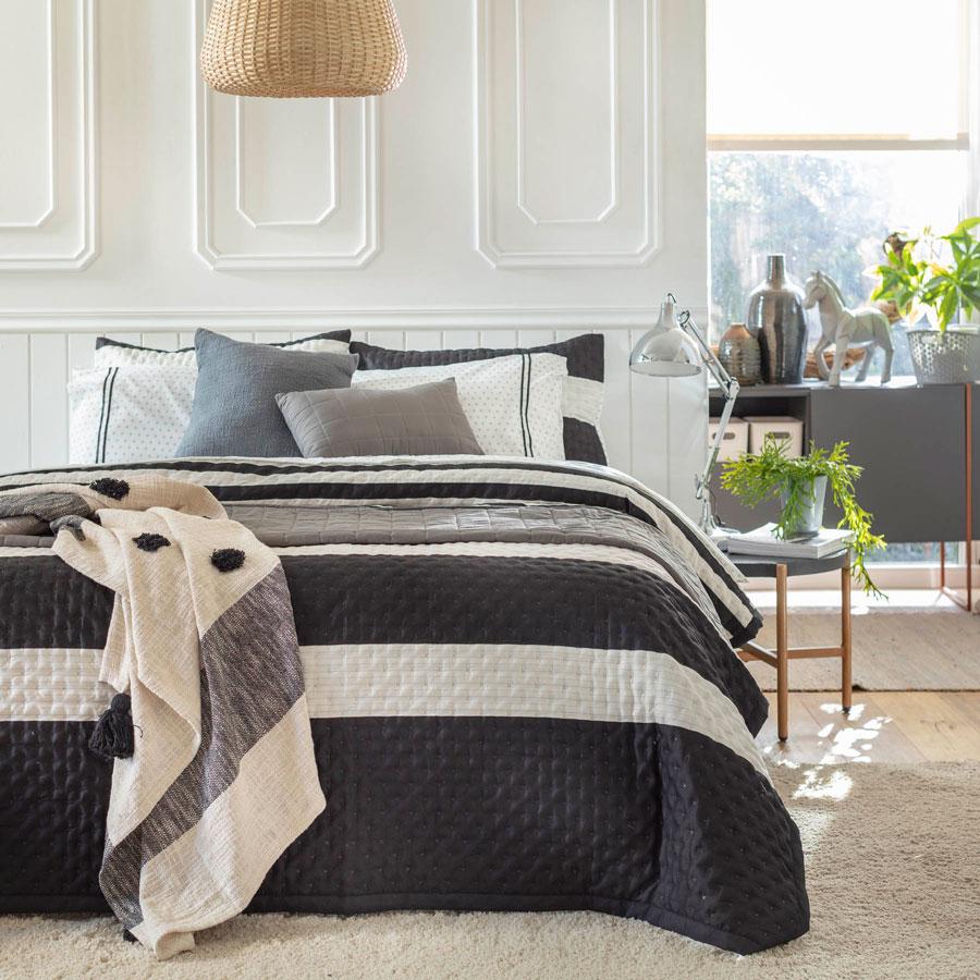 Textiles para primavera con color base negro y complementos en color blanco sobre ésta.