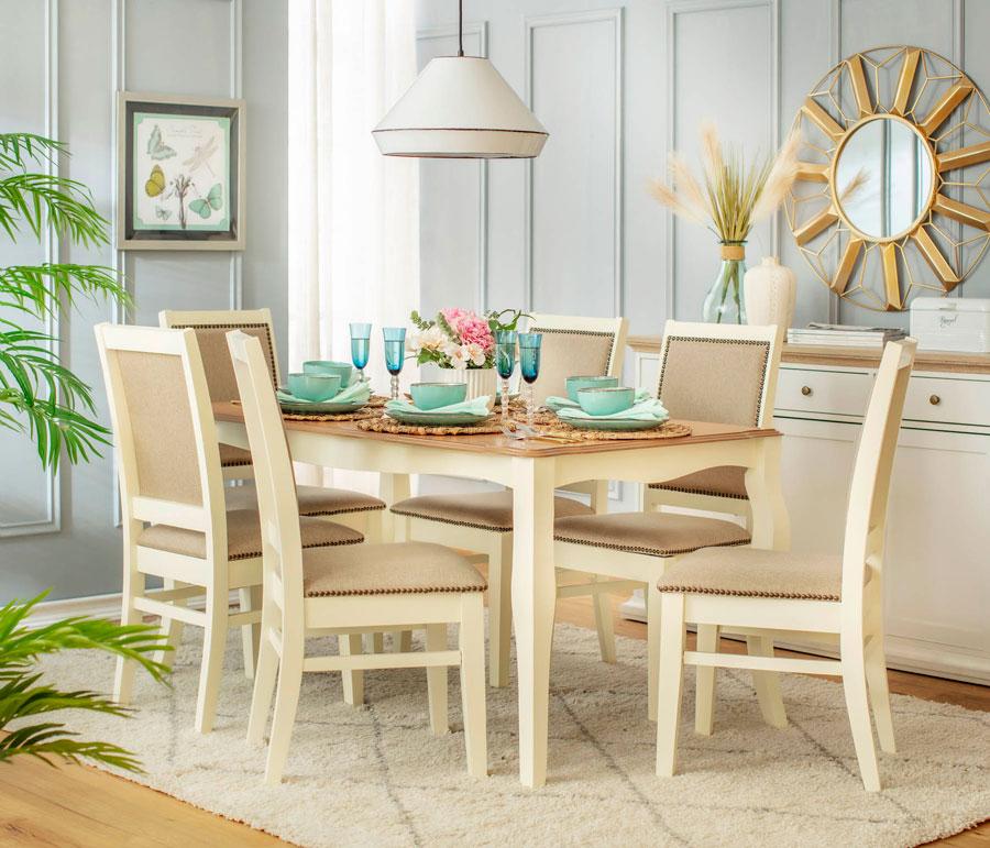 Comedor con una paleta de colores claros, que le da más amplitud a la habitación.